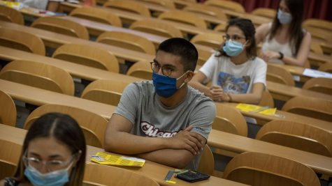 Students wearing masks in school.