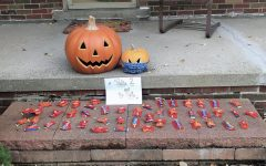 Candy is set out on the porch for kids to take