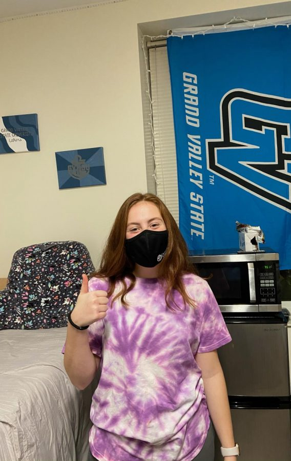 Hines is hanging out in her college dorm with her mask on.