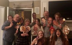 The Hambrick family holding up pictures of everyone who was not able to come to Thanksgiving because of Covid-19.