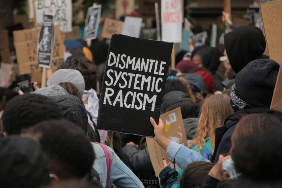 A protest is being demonstrated in the attempt to dismantle systemic racism.