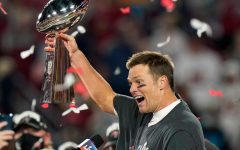 Tom Brady lifting the Lombardi Trophy after his seventh Super Bowl win.