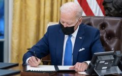 President Biden signing an executive order